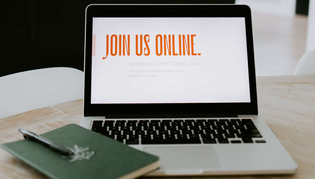 laptop on a desk displaying the words: join us online.