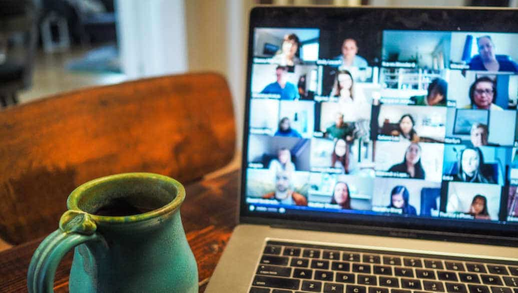 group video call displayed on a laptop.